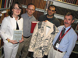 Judy Donnelly, project specialist, Rick Stapleton, archivist librarian, Nick Ruest, digital strategies librarian, and Carl Spadoni, research collections librarian, pose with some of the artifacts that will be available on a website about the history of Canadian publishing. Photo by Susan Bubak.